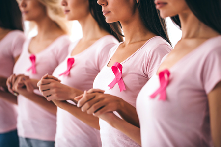 Photo for Cropped image of group of young multiracial woman with pink ribbons are struggling against breast cancer. Breast cancer awareness concept. - Royalty Free Image