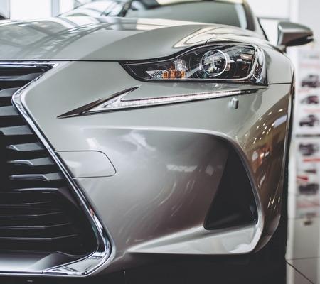 Foto de New car in showroom. Luxury exterior. Car dealership. - Imagen libre de derechos