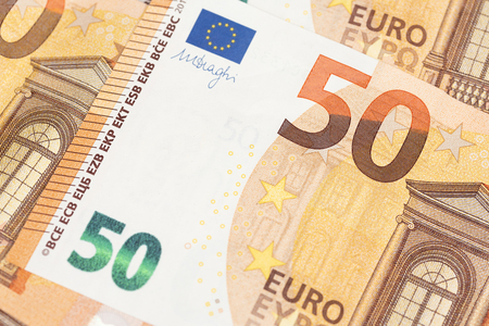 Close up of overlapping euro banknotes