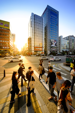 SEOUL, KOREA - OCTOBER 6, 2015 : Gangnam plaza shopping street, Korean people tourists walking shopping the neighbourhood. It is fashionable to be the most popular neighbourhood is must when travel