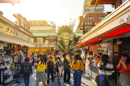 TOKYO JAPAN - MARCH 28, 2018 : Nakamise shopping street at Sensoji temple, Tourists walk shopping sweets & souvenirs before going to pay homage to statue in temple. Tokyo's must-see places to visit.