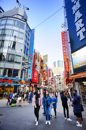 TOKYO JAPAN - MARCH 29, 2018 : Shibuya neighborhood, Unidentified tourists walk past this area has many shops full to shopping and restaurants. One of Tokyo's must-see places to visit.