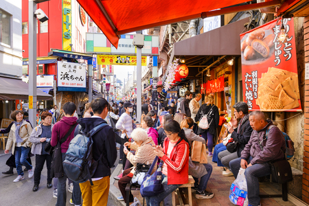 TOKYO JAPAN - MARCH 30, 2018 : Ameyoko market neighborhood, Unidentified tourists walk past this area has many shops full to shopping and restaurants. One of Tokyo's must-see places to visit.