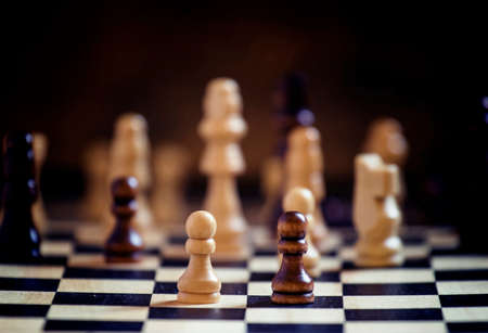 Photo for Chess pieces on a chessboard, black background, selective focus, shallow depth of field - Royalty Free Image