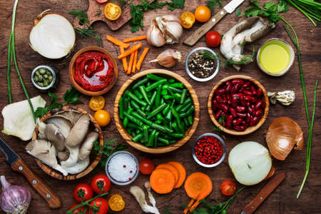 Photo for Food cooking background, ingredients for preparation vegan dishes, green bean, vegetables, roots, spices, mushrooms and herbs. Healthy vegetarian food concept. Rustic wooden table, top view, copy space - Royalty Free Image