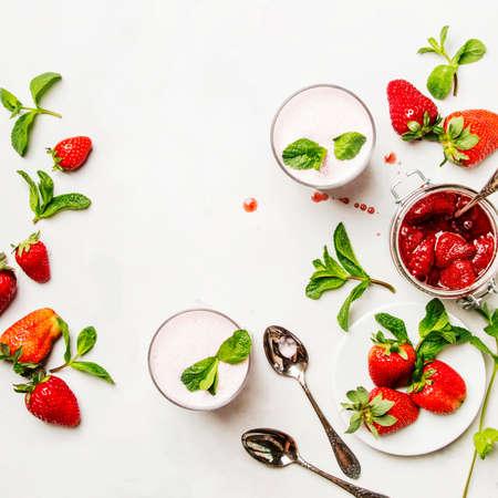 Photo pour Strawberry milkshake with mint, white background, top view - image libre de droit