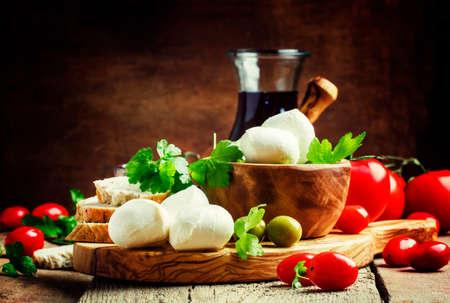 Foto für Mozzarella cheese, bread, olives and tomatoes, snack plate. Vintage wooden background, selective focus - Lizenzfreies Bild