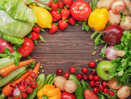 Foto für Healthy food. Assortment of fresh summer organic vegetables, fruits and berries on wooden table background - Lizenzfreies Bild