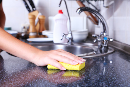 Photo for Cleaning kitchen with sponge - Royalty Free Image