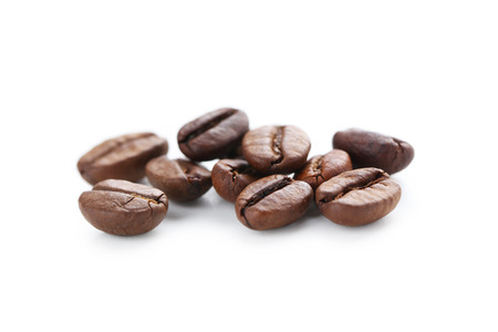 Roasted coffee beans isolated on a white
