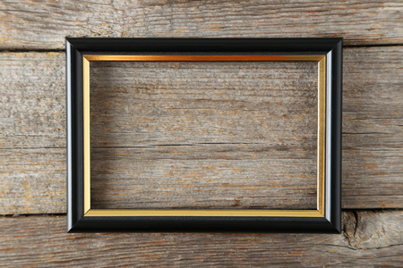 Photo for Wooden frame on grey wooden background - Royalty Free Image