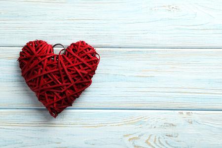 Photo pour Love heart on a blue wooden background - image libre de droit