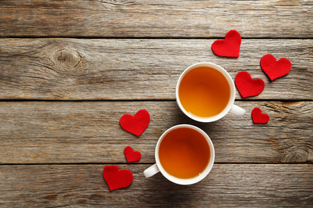 Photo for Love hearts with cups of tea on a grey wooden table - Royalty Free Image