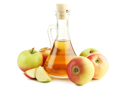 Photo pour Apple vinegar in glass bottle isolated on white - image libre de droit