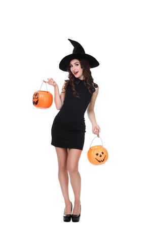 Photo pour Young woman in halloween costume with pumpkin buckets isolated on white background - image libre de droit