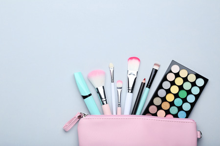 Foto de Different makeup cosmetics on grey background - Imagen libre de derechos