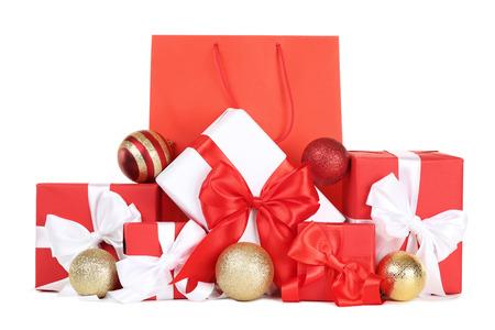 Foto de Shopping bag with gift boxes and christmas baubles on white background - Imagen libre de derechos