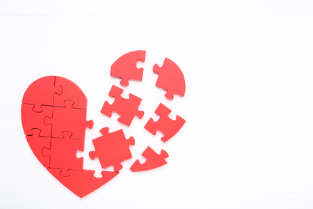 Photo for Puzzle heart on white wooden table - Royalty Free Image
