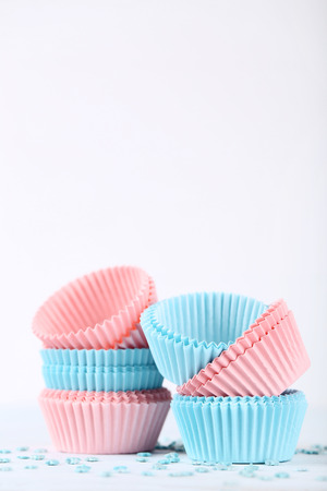 Photo for Colorful cupcake cases with sprinkles on white background - Royalty Free Image