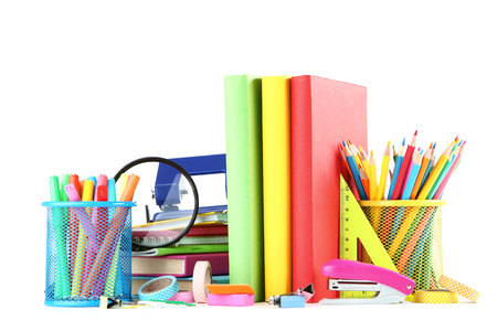 Foto de School supplies with books on white background - Imagen libre de derechos