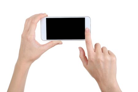 Photo for Female's hands holding smartphone on white background - Royalty Free Image