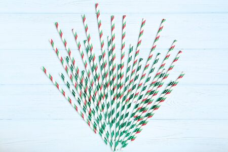 Paper straws on white wooden table
