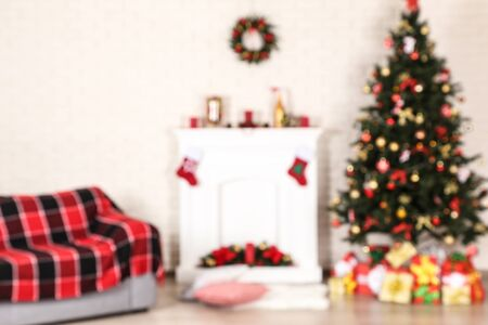Photo for Blurred background of fireplace near sofa and christmas tree - Royalty Free Image