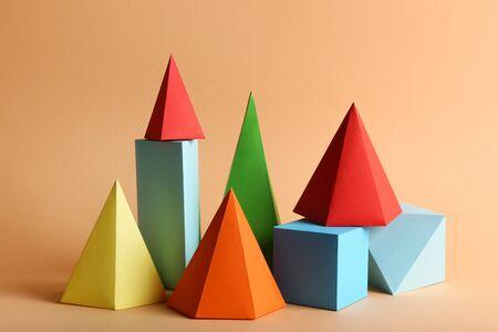 Foto de Colorful paper geometric figures on beige background - Imagen libre de derechos