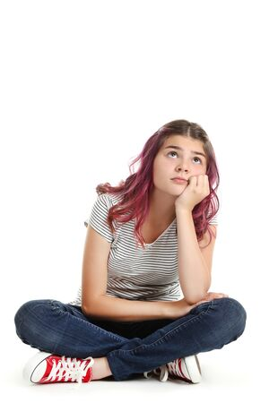 Photo pour Beautiful young girl sitting on white background - image libre de droit