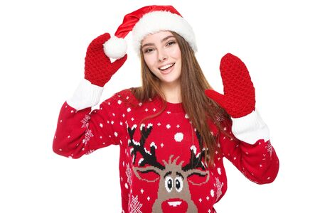 Photo pour Beautiful woman wearing christmas sweater, gloves and santa hat on white background - image libre de droit