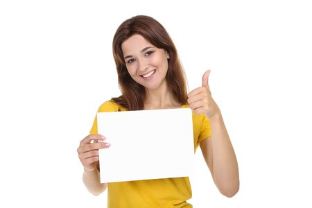 Photo pour Young woman with blank sheet of paper and thumb up on white background - image libre de droit