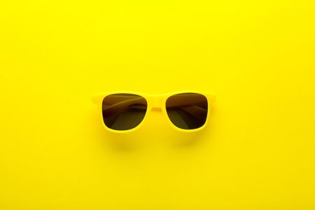 Photo pour Modern sunglasses on yellow background - image libre de droit