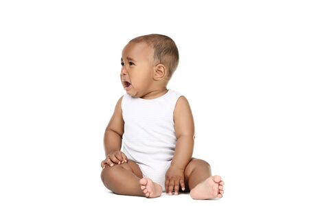 Photo pour American baby girl sitting on white background - image libre de droit