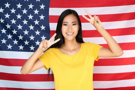 Photo for Young woman on American flag background - Royalty Free Image