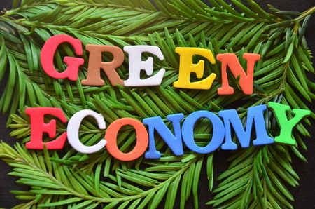 WORD GREEN ECONOMY on an abstract background
