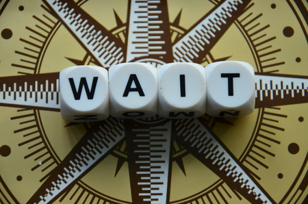 Word wait on an abstractly colored background