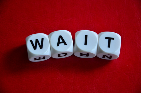 Word wait on an red background