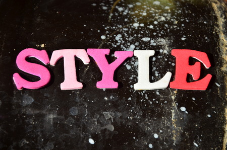 The word style on an abstract background