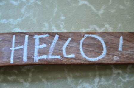 word hello on an abstract background