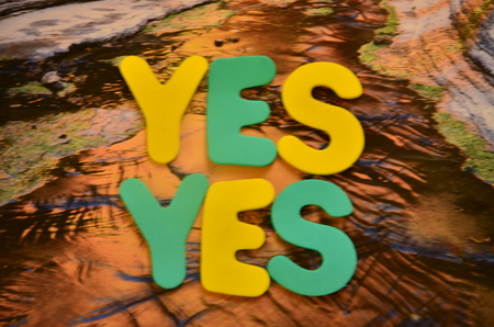 Word yes on an abstract background