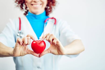 Photo pour Healthcare concept, doctor with a heart in his hands in a hospital. - image libre de droit