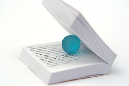 blue little ball and book