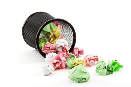 Spilled trash bin full of crumpled paper
