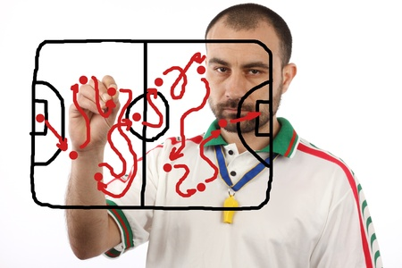 soccer menager drawing a tactical plan