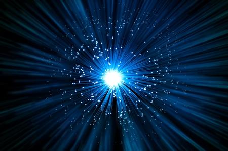 Photo pour Many illuminated blue fiber optic light strands emitting a blue light effect blur against a dark background. - image libre de droit