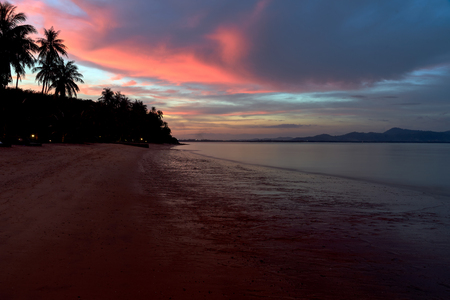 Photo for evening sunset on  Thai beach with palms in blue and red colours - Royalty Free Image