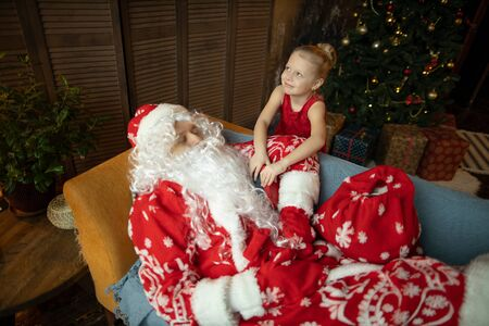 Santa Claus is preparing for Christmas and New Year, watching le