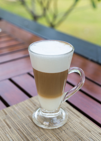 Latte macchiato in a glass with milk froth.