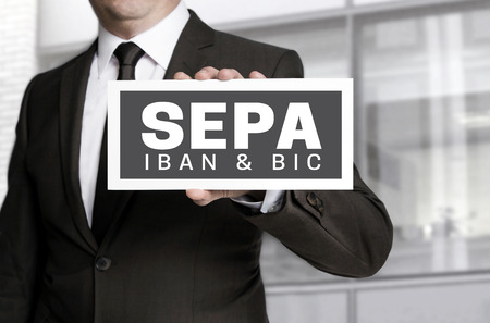Sepa sign is held by businessman.