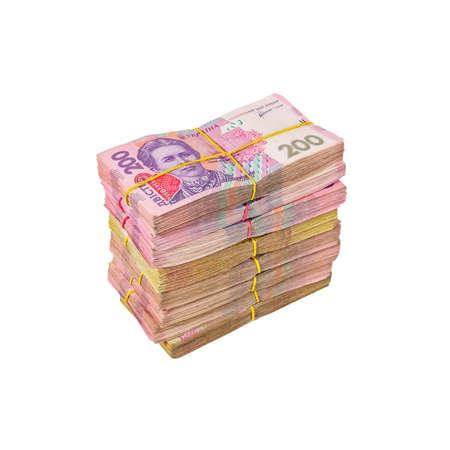 Photo pour Bundles of money tied with an elastic band. Ukrainian currency hryvnia - image libre de droit